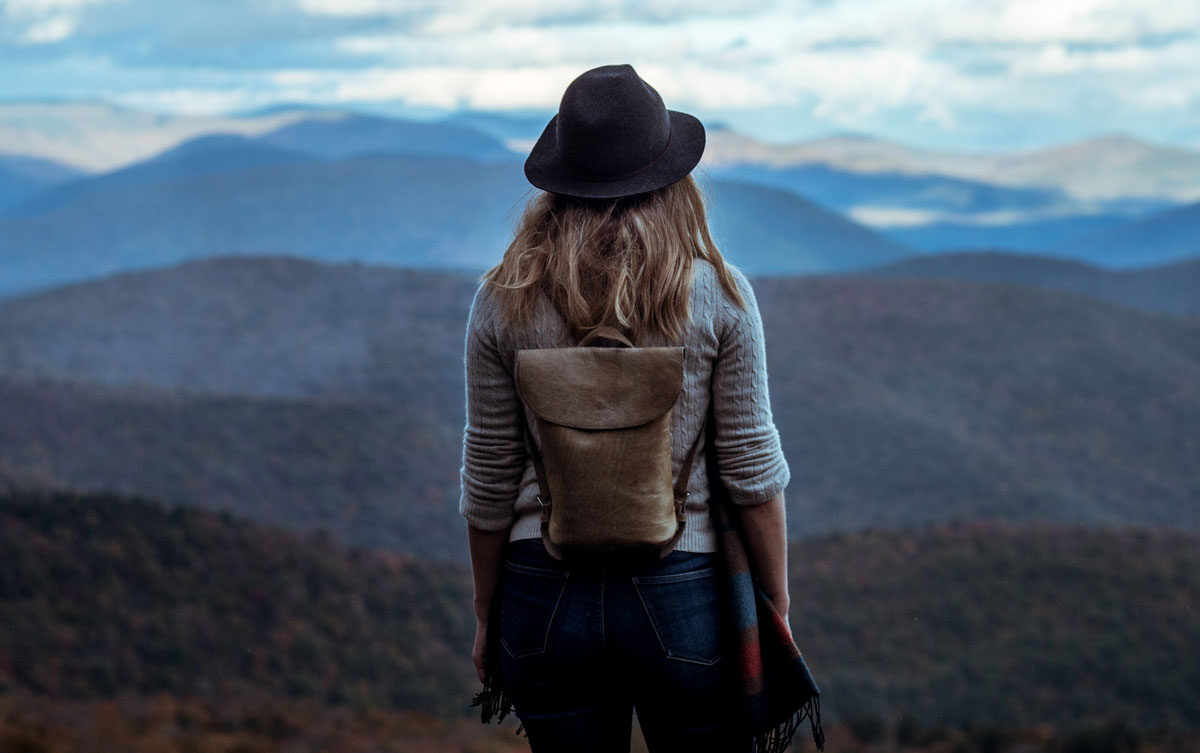 hiker looking out at mountains